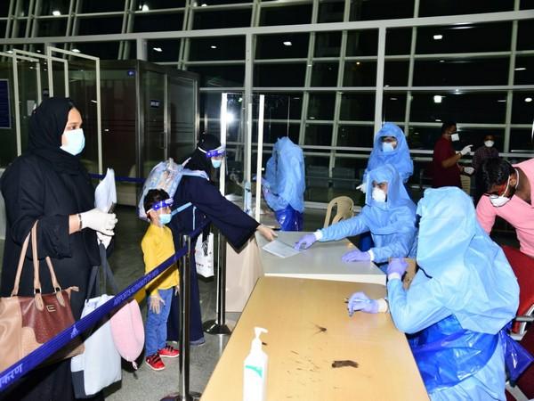 Passengers from the Air India's special flight from Dubai at Mangalore International Airport. (credit: Info Dept, Dakshina Kannada)