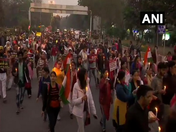 People hold a candlelight vigil in solidarity with the Unnao rape victim in New Delhi on Saturday.