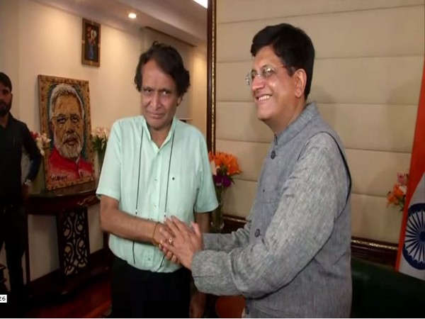 Suresh Prabhu, left, and Union Minister Piyush Goyal, right, at Udyog Bhawan in New Delhi on Friday. Photo/ANI