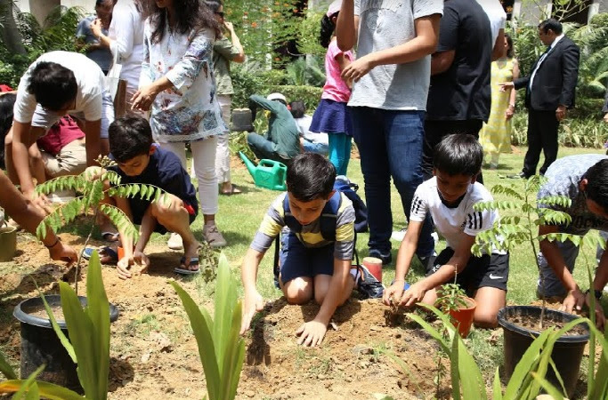 Plantation drive by residents on the occasion of World Environment Day at The Magnolias, DLF5, Gurugram