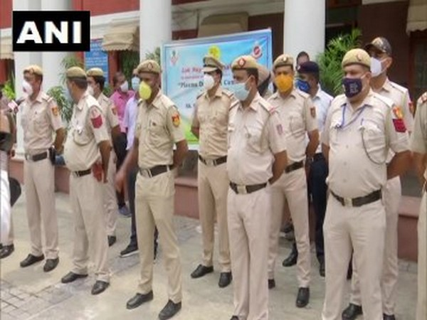 Policemen who have recovered from COVID-19 at Delhi's Lok Nayak Hospital.