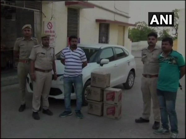 Two held with cartons of liquor. Photo/ANI