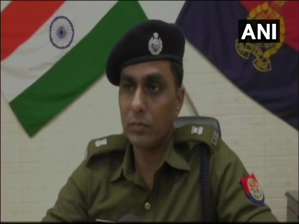 Police officers sharing details of the case lodged against PWD in Kanpur.