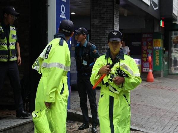 Local authorities secure the area outside the club where the mishap occurred in Gwangju, South Korea on Saturday (Photo/Reuters)