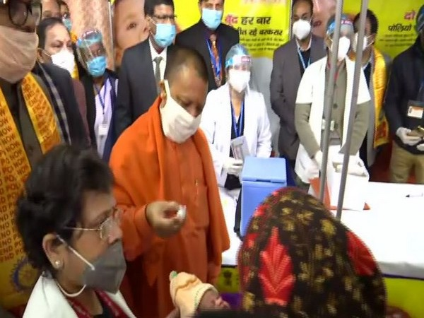 CM Yogi administering polio doses at launch of the event