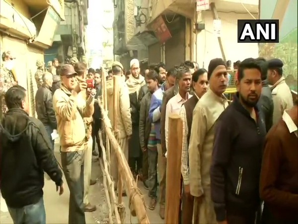 People casting their votes at a polling station in Delhi on Saturday. .