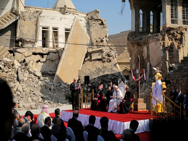"""Standing amid the rubble left by ISIS terrorists in Iraq, Pope Francis said that hope is """"more powerful than hatred."""" (Photo credit: Reuters)"""