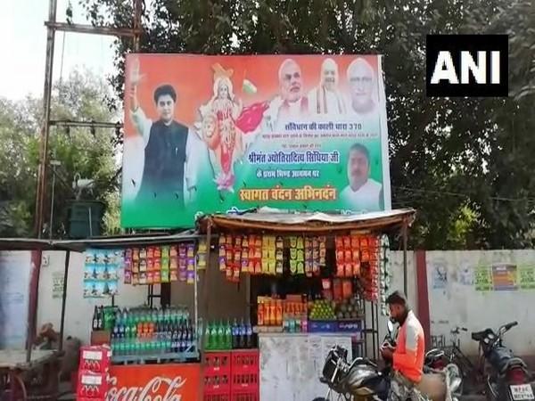 A poster of Congress leader Jyotiraditya Scindia along with PM Narendra Modi and Home Minister Amit Shah in Bhind of Madhya Pradesh on Friday.
