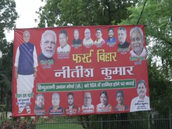 HAM(S) poster put up in Patna after the party joined NDA recently. [Photo/ANI]