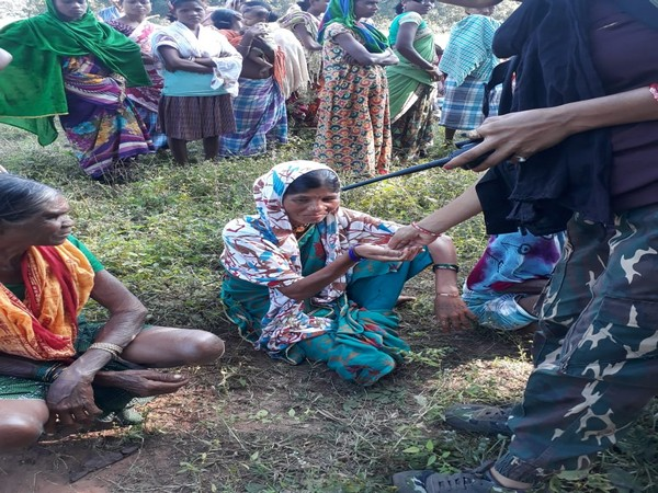 Villagers meet with the security officials at Potali camp