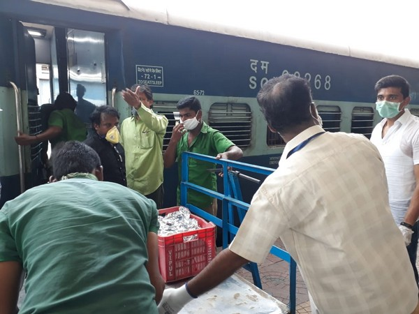 Catering services being provided by the South Central Railway (SCR) official at one of the Shramik Special Trains.