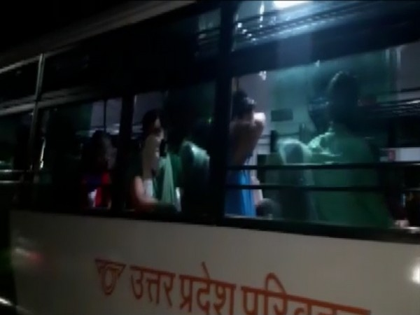 Visuals of students in a bus.