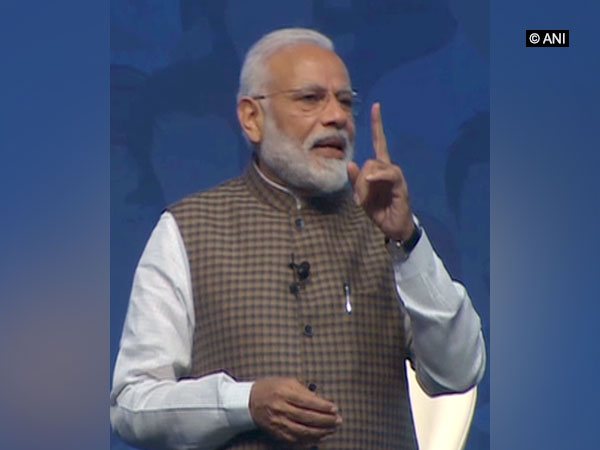 Prime Minister Narendra Modi speaking at 'Mai Bhi Chowkidar' programme in New Delhi on Sunday. Photo/ANI