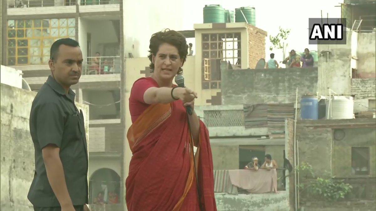 Congress General Secretary Priyanka Gandhi Vadra addressing a roadshow in Delhi.