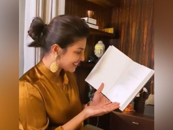 Actor Priyanka Chopra holding her memoir 'Unfinished' (Image Source: Instagram)