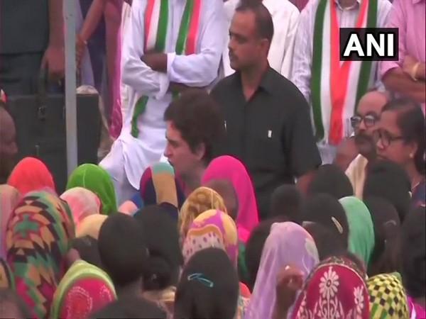 Congress leader Priyanka Gandhi Vadra meeting families of the Sonbhadra massacre victims on Tuesday. (Photo/ANI)