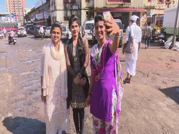 People participating in 'Selfie with Potholes' campaign in Mangaluru on Friday.
