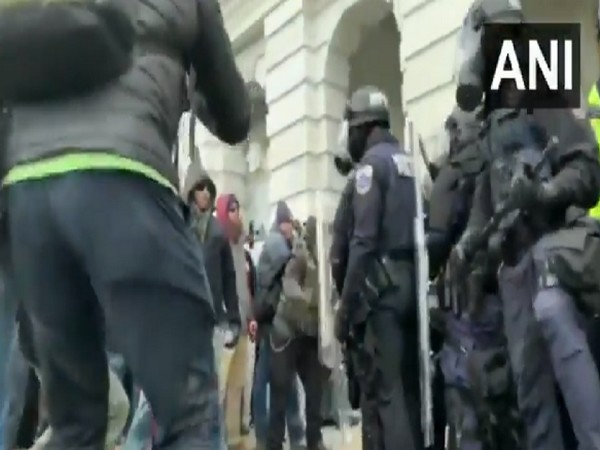 Protesters clash with police outside the US Capitol in Washington (Photo/ANI)