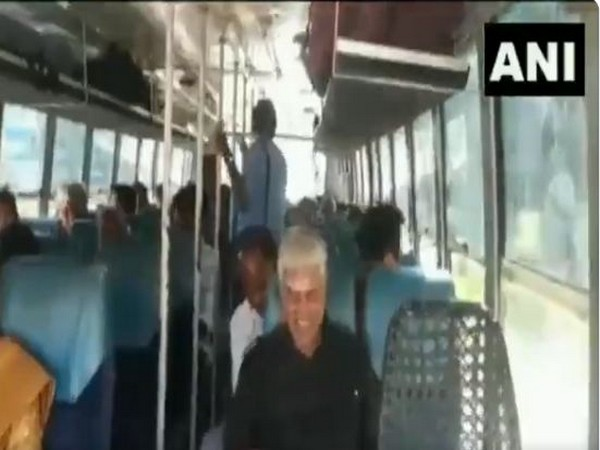 Puducherry Agriculture Minister travelling in a public bus on Friday