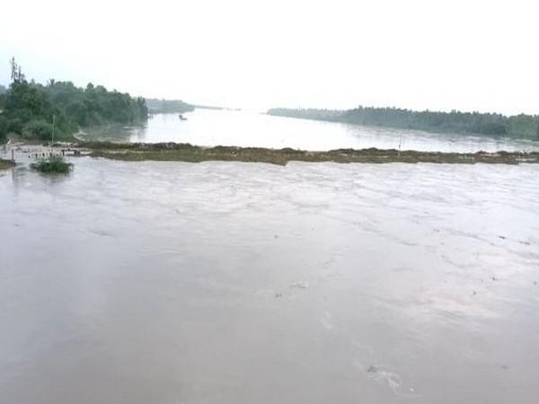 Puligadda bridge submerged under floodwaters due to heavy rains. Photo/ANI