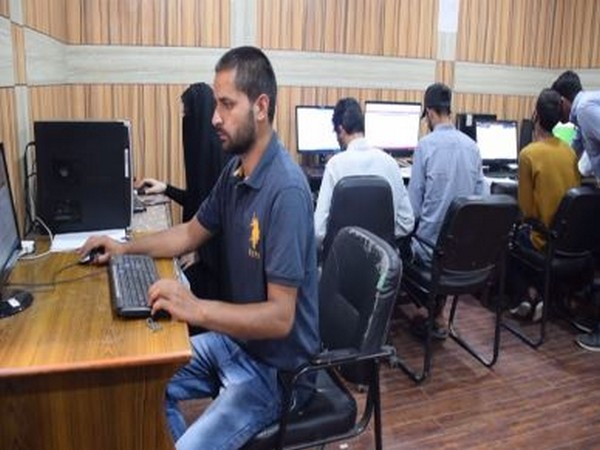 Students availing the faclities at the internet facilitaiton centre in Pulwama. Photo/ANI
