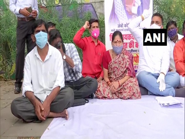 Kin of a 33-year-old woman patient, who allegedly went missing from a COVID-19 jumbo hospital, staged protest in Pune. (Photo/ANI)