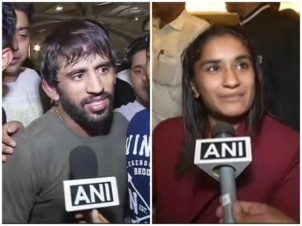 Indian wrestlers Bajrang Punia and Vinesh Phogat