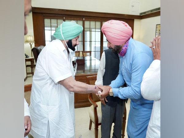 PCC chief Navjot Singh Sidhu meets Chief Minister Captain Amarinder Singh. (Photo/ANI)