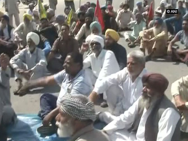 Farmers union staging a sit-in protest on Tuesday over the suicide of a farmer in Punjab. Photo: ANI.
