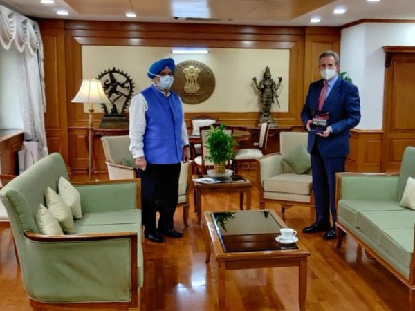 Australian High Commissioner to India Barry O'Farrel with Civil aviation minister Hardeep Singh Puri at his office on Friday