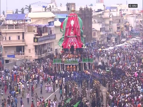 Several devotees pulling the rath from the place of its construction to the Lion's gate of Shree Jagannath Temple