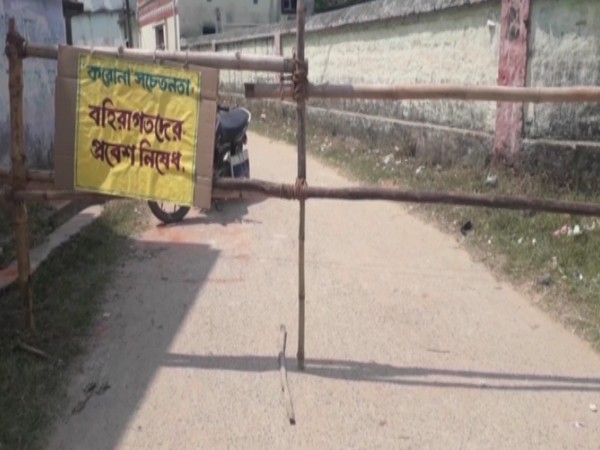 Entrance to a village in Purulia district has been blocked and a sign reading - Outsiders are barred from entering the area in the wake of coronavirus - has been put up. Photo/ANI