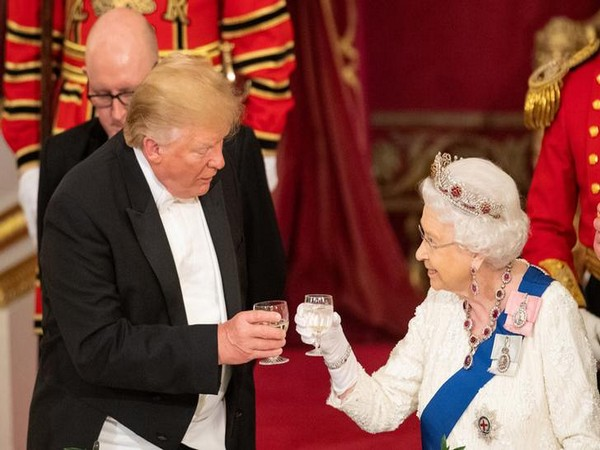 U.S. President Donald Trump and Britain's Queen Elizabeth raise their glasses to make a toast at the State Banquet at Buckingham Palace in London on Monday. (Photo courtesy: Reuters)