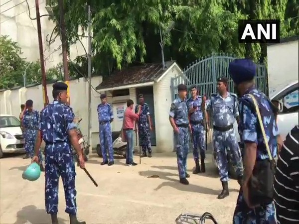 Police and Rapid Action Force (RAF) present outside the residence of former Samajwadi Party MP, Atiq Ahmed.