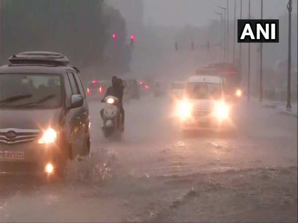 Rain lashed parts of Delhi on Sunday afternoon. Photo/ANI