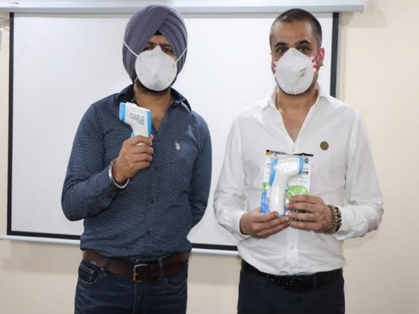 Maninder Singh and Arjun Prasad (Bal Bharti Foundation) with Make in India InfraRed Thermometer