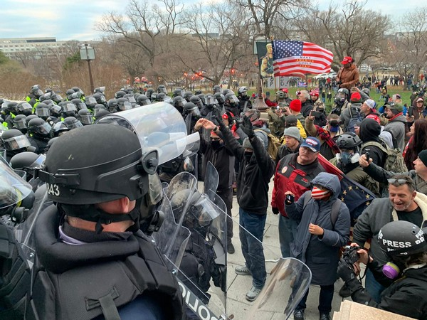 Protesters clashing with police officers outside US Capitol in Washington.