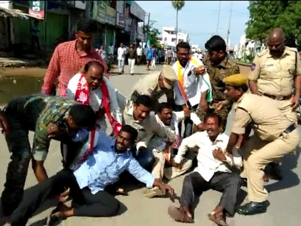 Police prevents striking RTC workers from halting buses in Parakala on Saturday. Photo/ANI