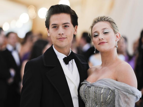 Cole Sprouse and Lili Reinhart posing at Met Gala 2018.