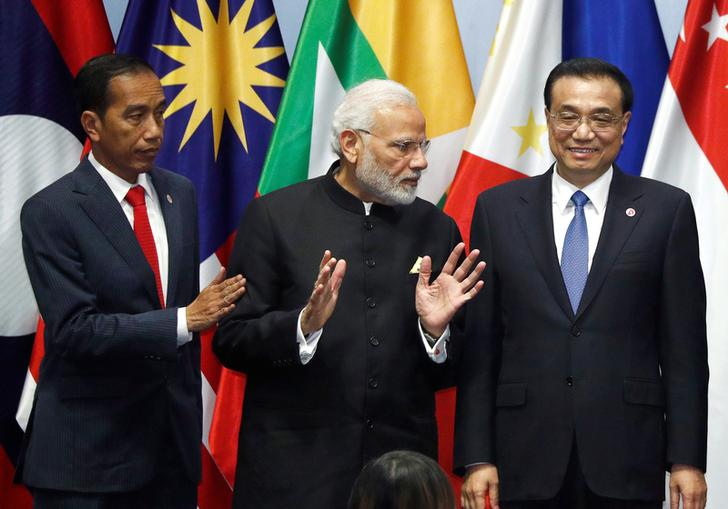 India's Prime Minister Narendra Modi with China premier Li Keqiang and  Indonesia's President Joko Widodo at RCEP meeting in Singapore in 2018
