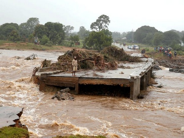 A man looks at a washed away bridge along Umvumvu river following Cyclone Idai in Chimanimani, Zimbabwe