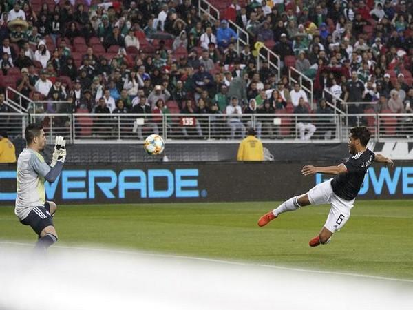 Mexican footballer Jonathon dos Santos scores a goal against Paraguay