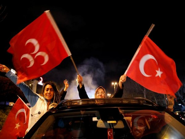 Supporters of Erdogan's AK party wave flags in Istanbul on Sunday