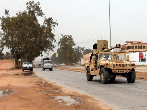 A military vehicle of Misrata forces, under the protection of Tripoli's forces, is seen on the road of Wadi al Rabih south of Tripoli, Libya