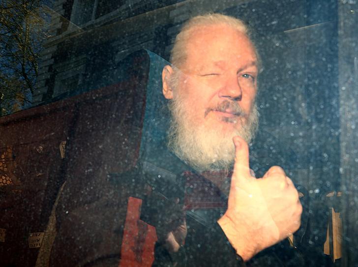 Wikileaks founder Julian Assange following his arrest
