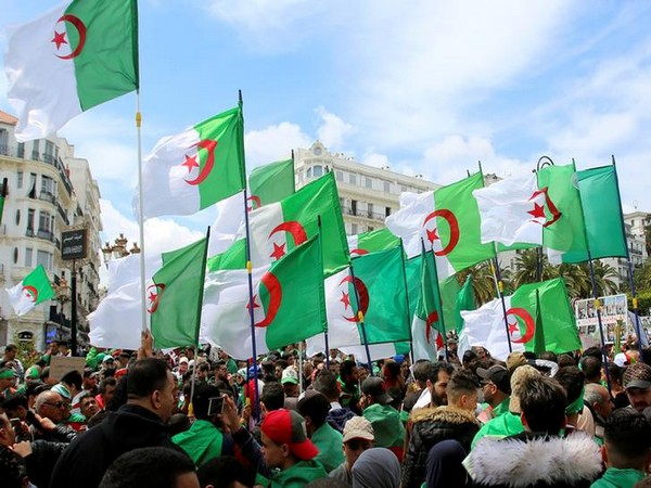 People carry Algeria national flags