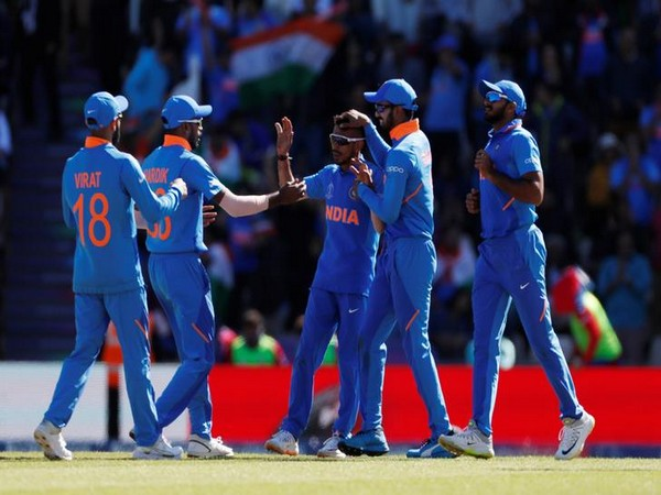 India's Yuzvendra Chahal celebrates with team mates after taking the wicket of Afghanistan's Rahmat Shah