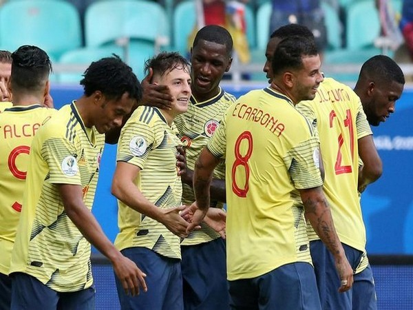 Colombian players celebrating after scoring goal against Paraguay