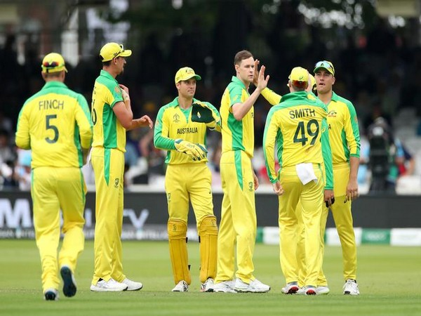 Australia's Jason Behrendorff celebrates with teammates after taking the wicket of England's Moeen Ali