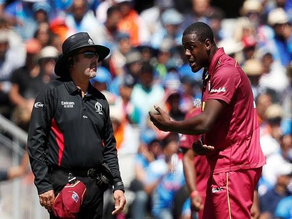 West Indies player Carlos Brathwaite with umpire on Thursday.